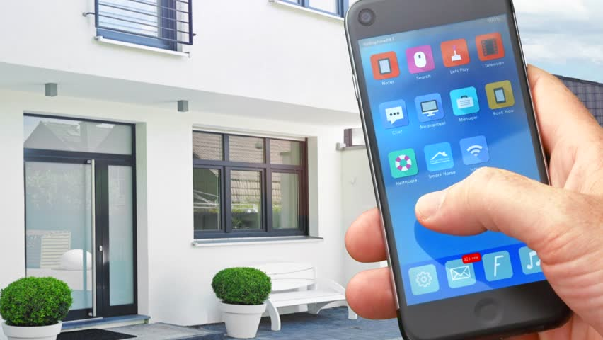 smart house, home automation, device with app icons. Man uses his smartphone  with