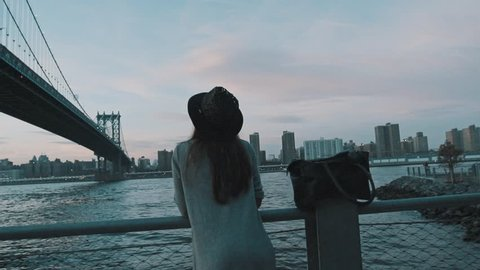 Travel. Girl is photographing (capturing) pictures of New York city.
