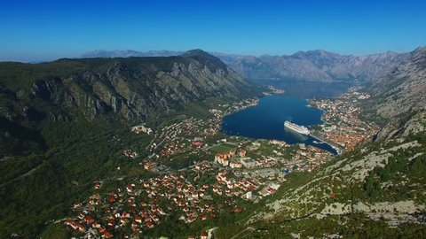 Bay of Kotor with bird's-eye view. The town of Kotor, Muo, Prcanj, Tivat. View of the mountains, sea. Large ocean liner moored in the Bay of Kotor. The old town of Kotor. Autumn in Montenegro
