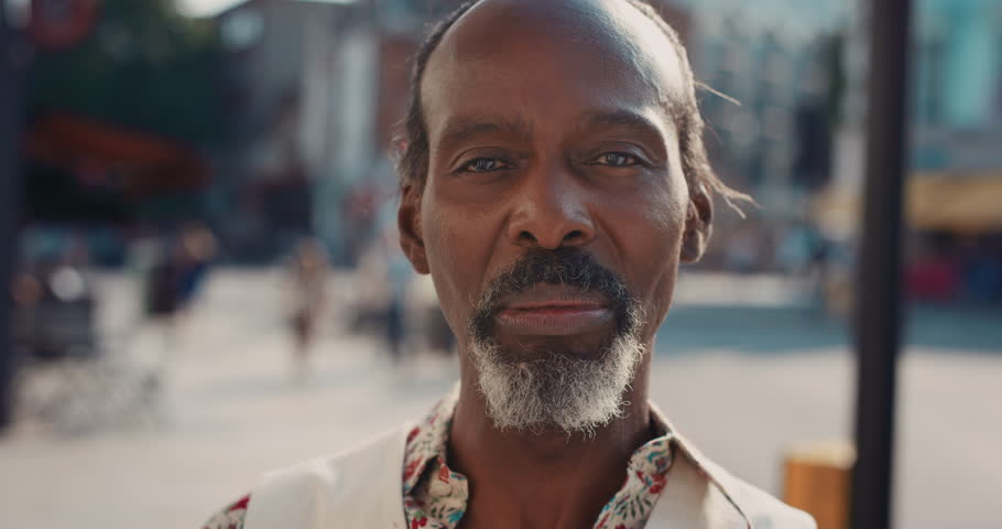 Slow Motion Portrait of happy mature african american man smiling in city real people series