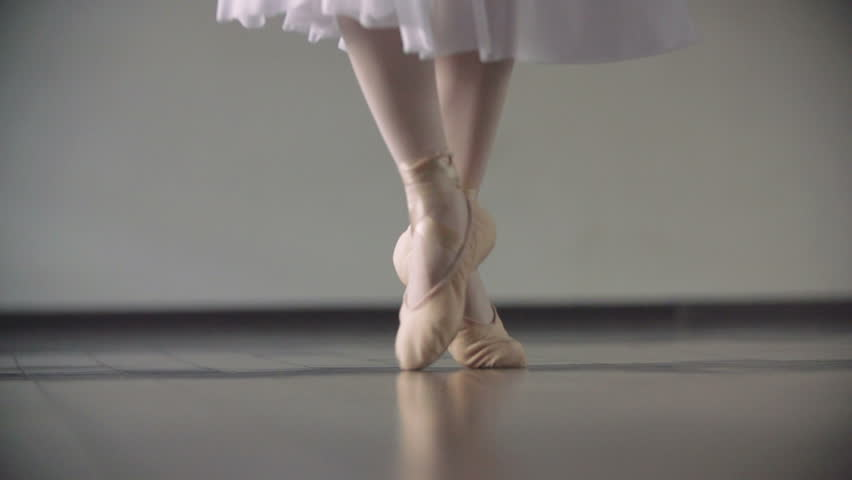 Close up of a ballet dancer's feet as she practices point exercises,slow motion
