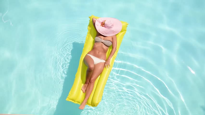 Young pretty woman lying on air mattress in the swimming pool | Shutterstock HD Video #12695264