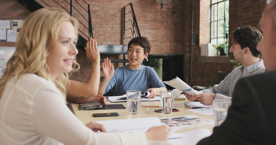 Multi-ethnic business team meeting involved diverse people participating in creative sustainable ideas steadicam shot across boardroom table shared work space | Shutterstock HD Video #12720482