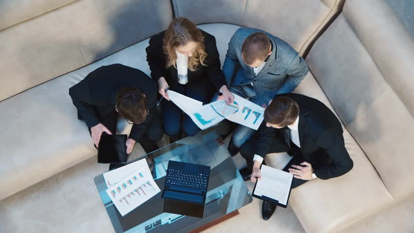 Working with data, people in the business meeting: top view | Shutterstock HD Video #12727094