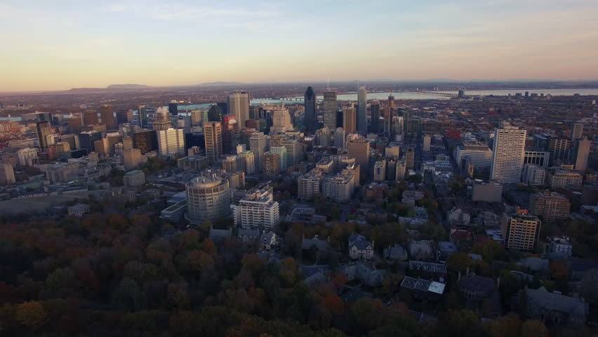 4K aerial drone shot of montreal skyline high forward move at sunset | Shutterstock HD Video #12731372