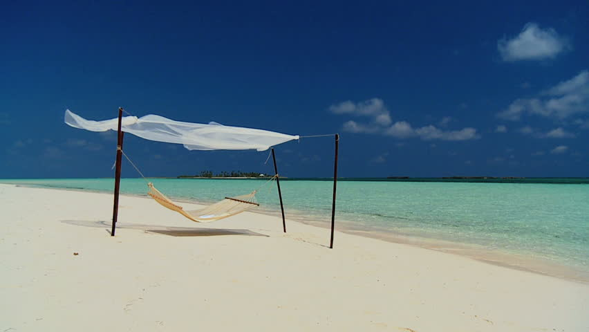 Hammock swaying lazily on a remote beach inviting relaxation