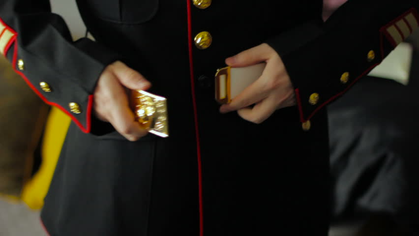 Marine putting on belt.