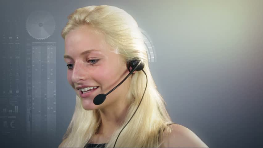 Call center employee on headset talking, surrounded by virtual graphs   Shutterstock HD Video #1277044