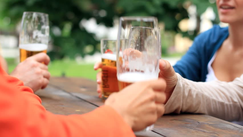 Four friends drinking beer, outdoors