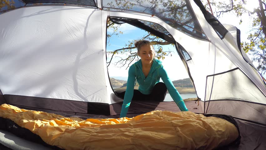 Woman Setting Up The Inside Of Her Camping Tent Stock Footage Video 12814184