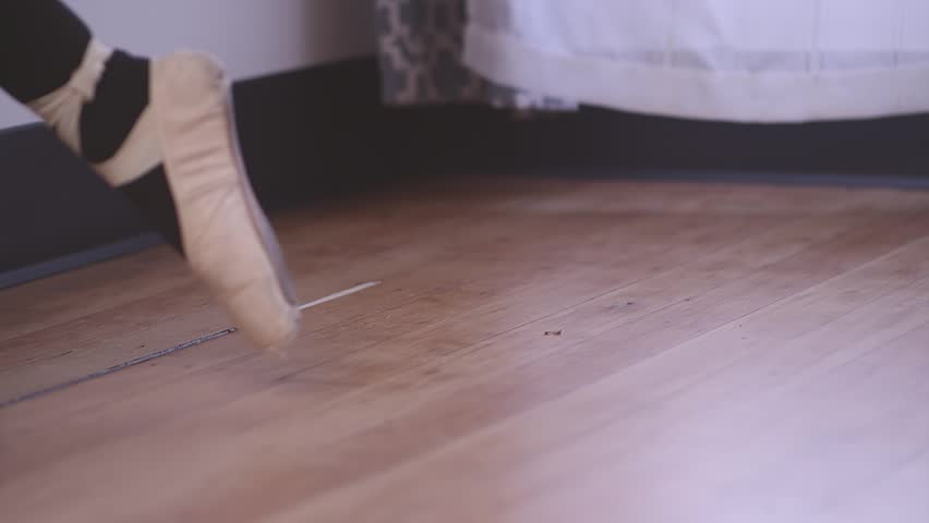 Close up of a ballet dancer walking across a studio floor in pointe shoes | Shutterstock HD Video #12831404