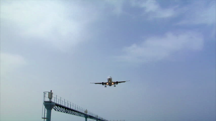 airplane landing over seaside