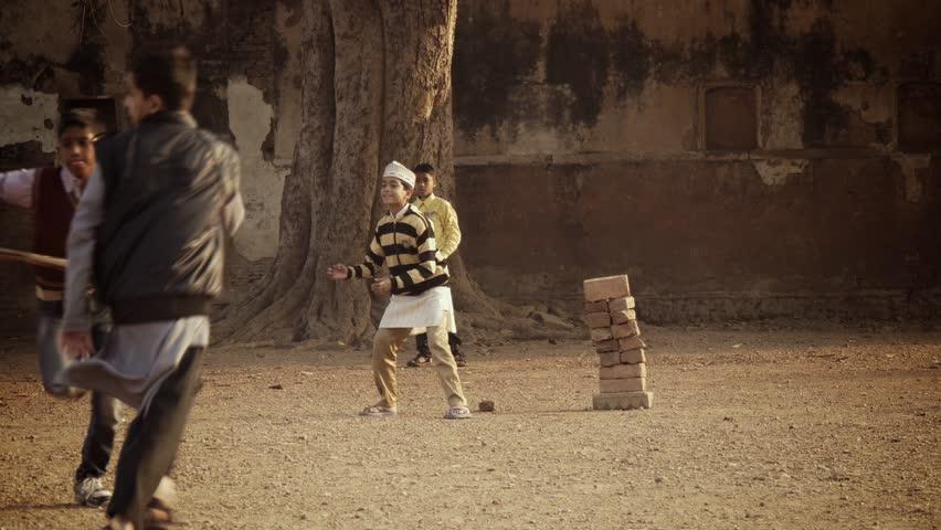 varanasi, india, young boys playing cricket, february 2015