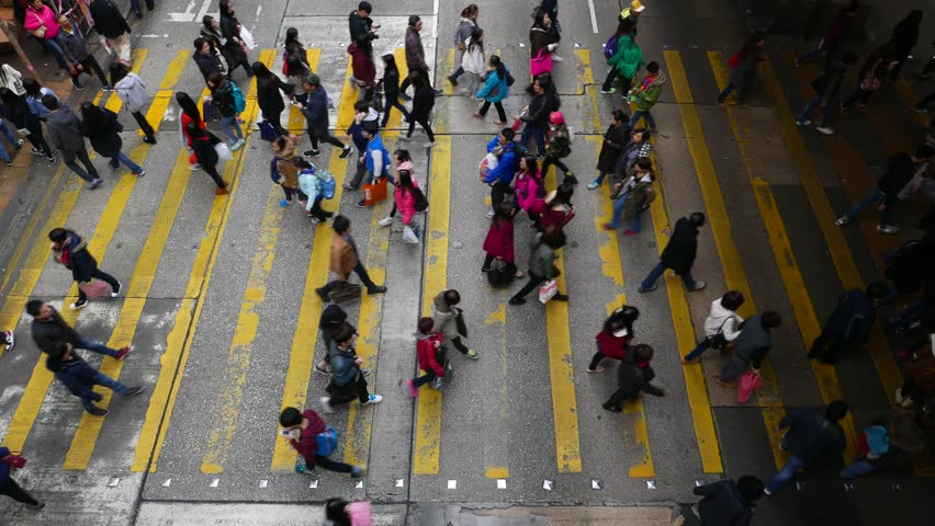 HONG KONG - FEBRUARY 07, 2015: View down to crosswalk, sparse car traffic and then throng crowdy people flow, crossing the street in peak hour | Shutterstock HD Video #12907664