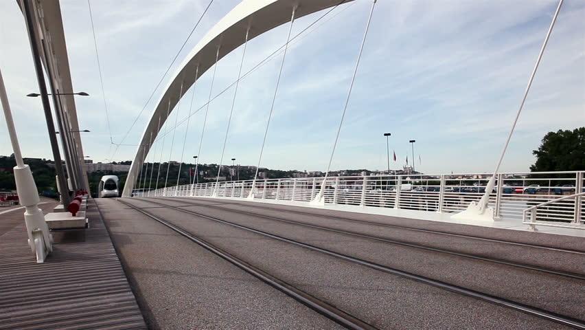 LYON, FRANCE - MAY, 2015 : Passage of the tramway on the bridge Raymond Barre