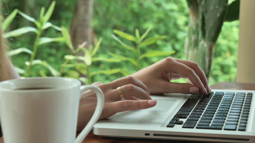 Close Up Of Womanu0027s Hands Typing On Laptop Computer, Outdoors. Young Woman  In Luxury Garden With Cup Of Coffee And Laptop, Slow Motion.