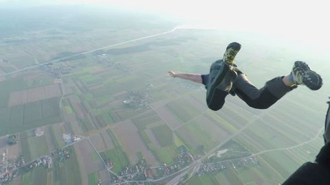 A guys is jumping off a plane and sky diving. We can see the landscape in this video below and also his jump.