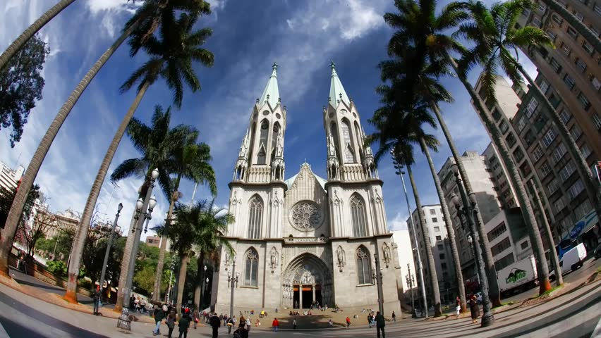 SAO PAULO, BRAZIL - JUNE 20: People walk in front of Catedral Da Se, the Roman Catholic Archdiocese of Sao Paulo Brazil June 20 2011. Catedral Da Se is considered the 4th largest neo-gothic cathedral in the world.