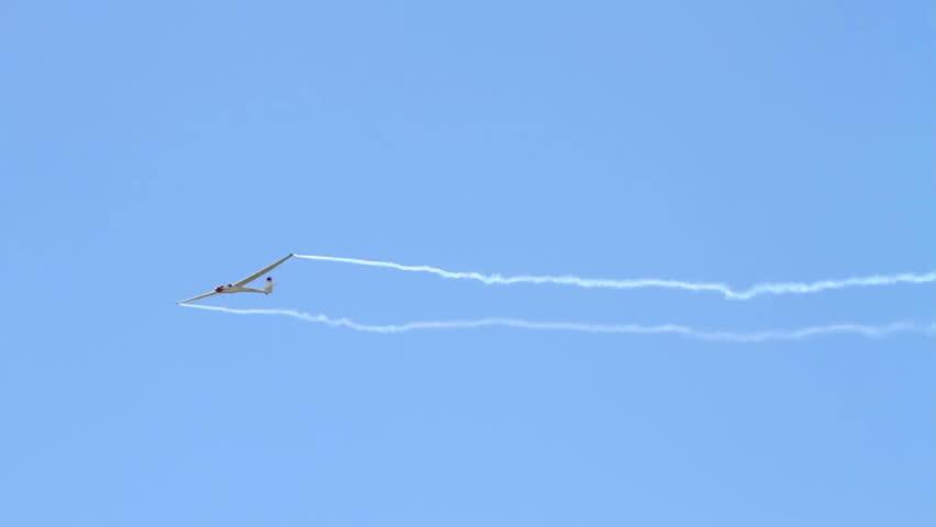 Sailplane performing elegant aerobatics