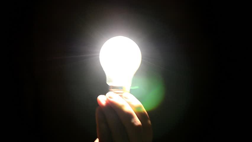 f917b39db9c Hand Holding a Light Bulb Stock Footage Video (100% Royalty-free) 13048094