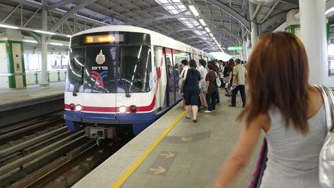 BANGKOK - MARCH 21, 2015: Metro train arrive, people loading into, POV camera come inside. Overground Punnawithi station, located at Sukhumvit road, Bang Chak district. BTS Bangkok Mass Transit System