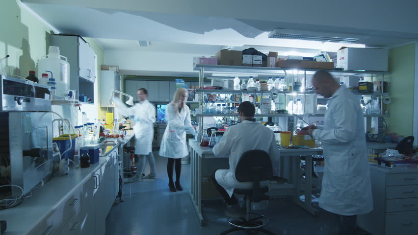 Timelapse footage of a team of scientists in white coats that are working in a modern laboratory. Shot on RED Cinema Camera in 4K (UHD). | Shutterstock HD Video #13089422
