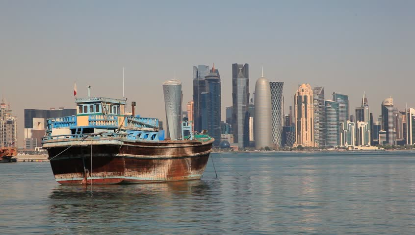 Traditional Arabic dhow and skyline of Doha downtown in Qatar, Middle East