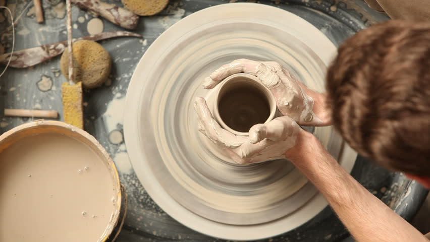 Cinemagraph - Overhead view of man making pot on pottery wheel. Looping Motion Photo.  | Shutterstock HD Video #13097054