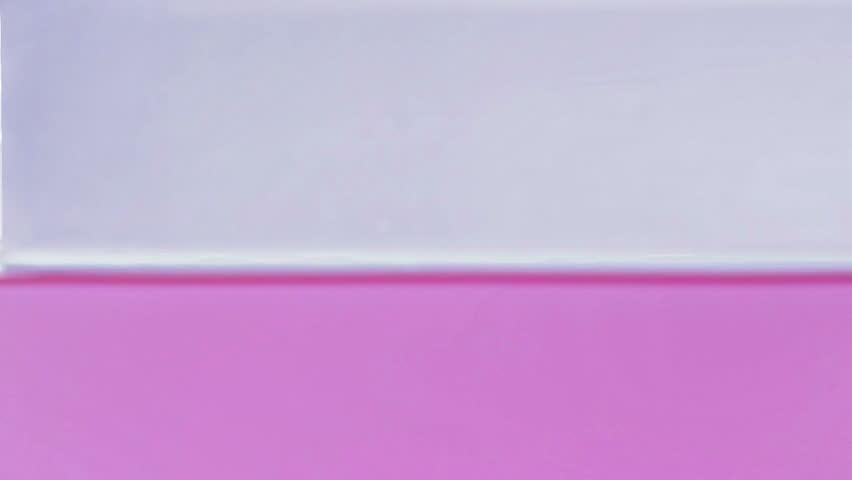 Slow motion droplets splashing in pink water | Shutterstock HD Video #13102304