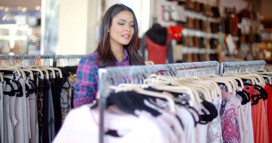 e2c6d3042511f Young beautiful girl doing shopping in a clothing store