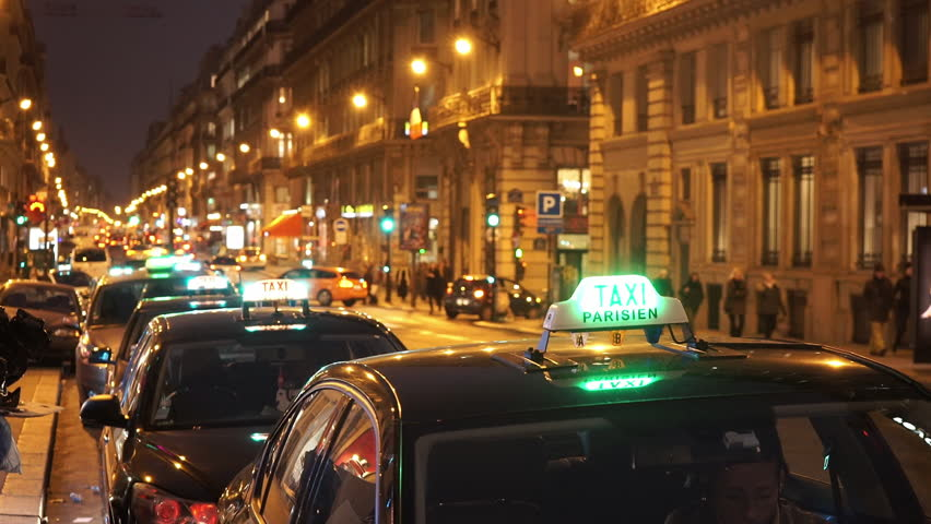 Street traffic in Paris by night with a lot of taxi cabs | Shutterstock HD Video #13120094