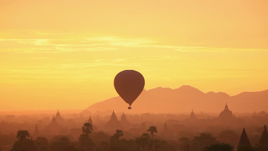 Bagan, Myanmar - December 31, 2014 : Hot air balloon over the temple of Bagan at dawn. 