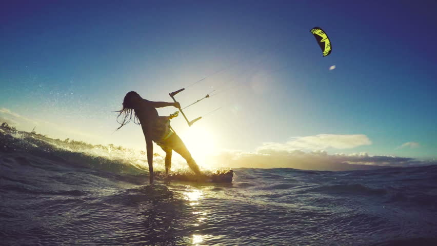 Extreme Kitesurfing at Sunset. Summer Ocean Sport in Slow Motion. Girl Kite Surfing in Bikini | Shutterstock HD Video #13139534