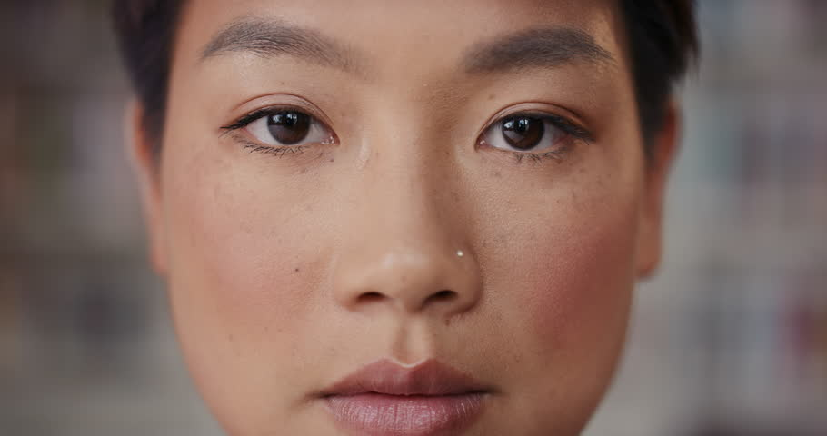Dramatic Close up of beautiful Asian woman serious portrait slow motion soft natural light on face center crop #13145192
