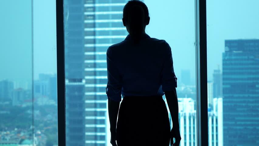 Businesswoman admire view from window in office  | Shutterstock HD Video #13161644