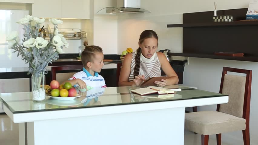 Mom and son looking in the phone | Shutterstock HD Video #13167914
