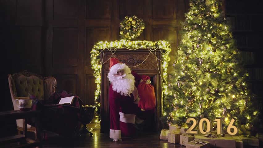 Santa Claus falling, shaking himself and coming up from fireplace with magic at Christmas night | Shutterstock HD Video #13180754