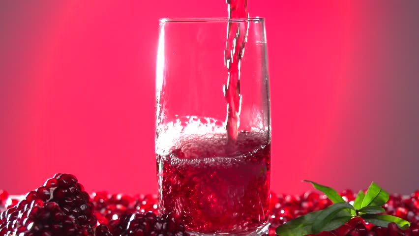 Pomegranate Juice Slow Juicer : Garnet. Pomegranate Juice Is Poured Into A Glass. Slow Motion 240 Fps. High Speed Camera Shot ...