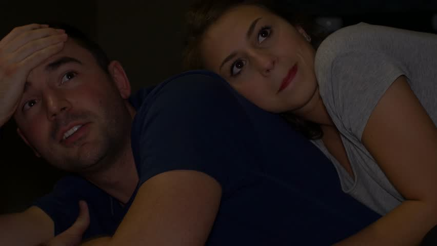 Couple cuddling watching gross and funny part of movie | Shutterstock HD Video #13201364