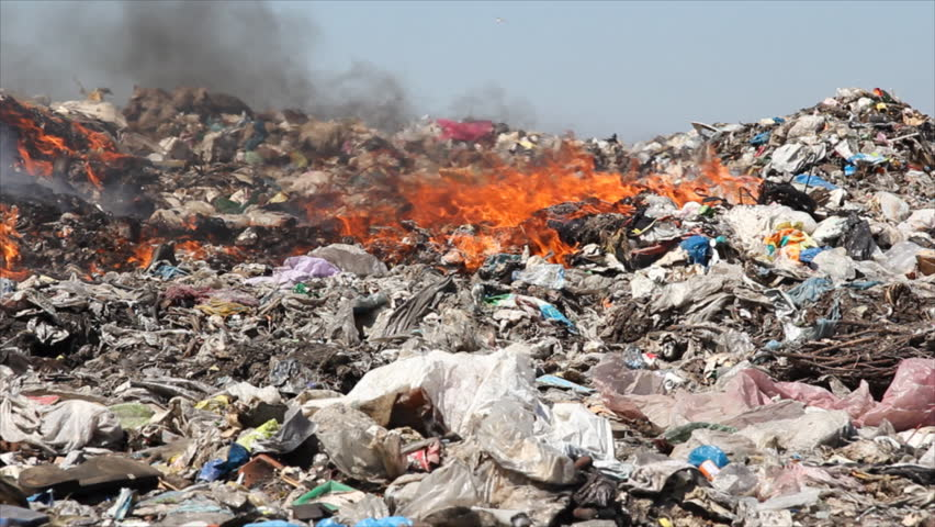 Burning garbage dump, ecological pollution
