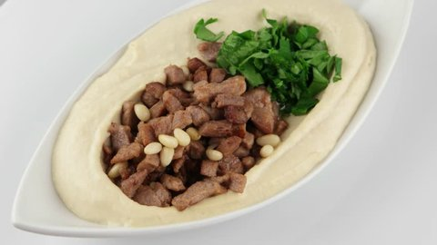 The hummus with meat and pine nuts