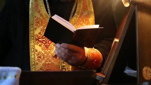Priest reading the Bible in church. Wedding in the Orthodox Church, the rite, the priest reads a psalm from the Bible.