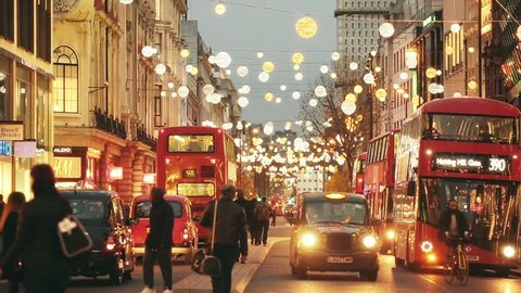LONDON, UK - NOVEMBER 23, 2015: Oxford street with Christmas lights and traffic. It is one of the busiest street of the capital city of England, and during Christmas time it becomes magic and fairy.