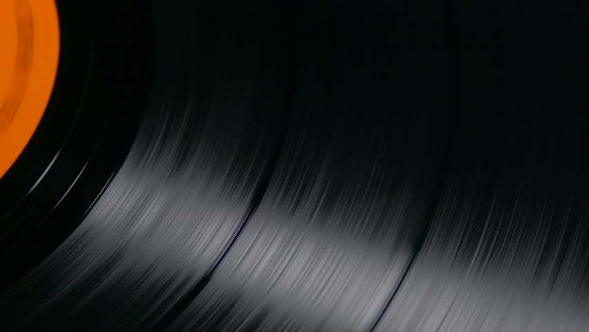 Ungraded: Vinyl record spinning on a turntable at 33 RPM. Audio tracks. Source: Lumix DMC, ungraded H.264 from camera without re-encoding. (av18953u)