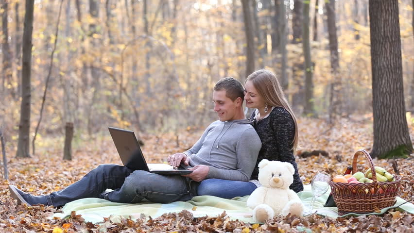 Couple with laptop in the autumn forest | Shutterstock HD Video #13254851