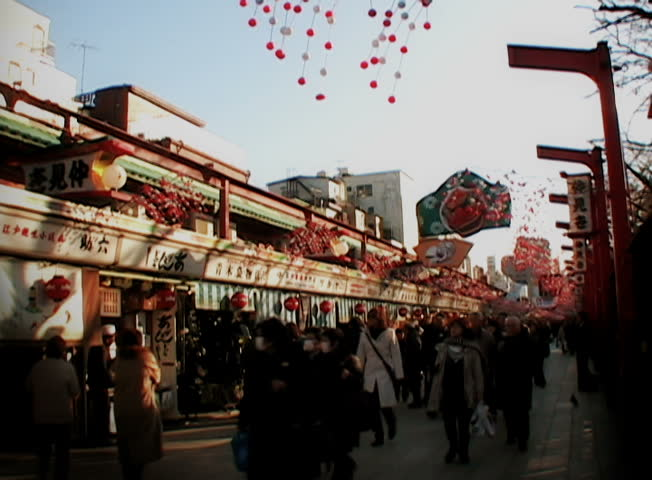 YOKOHAMA, JAPAN - CIRCA DECEMBER 2007 - Crowded Japanese market street, circa December 2007. Yokohama is the capital of Kanagawa and the second largest city in Japan by population after Tokyo.