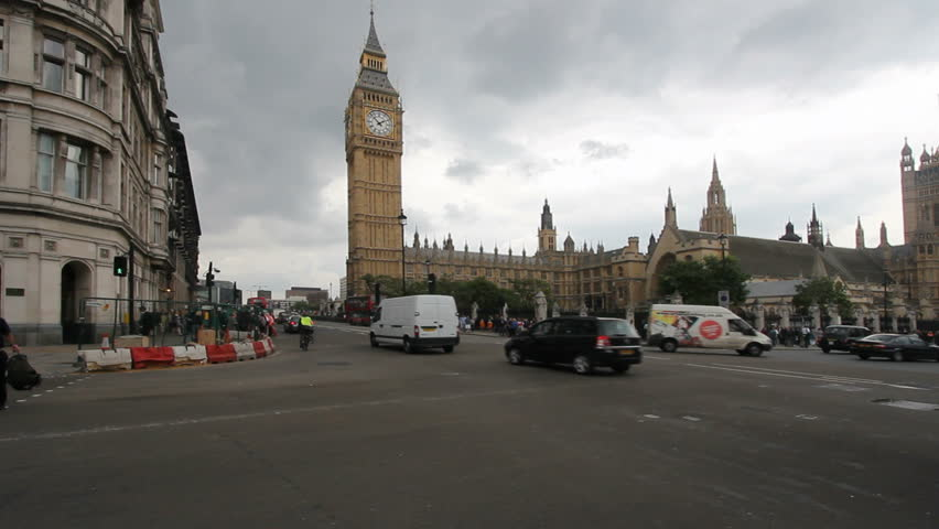 Public bus and other traffic drives past Big Ben in London