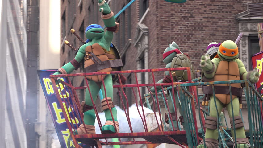 NEW YORK CITY, NY - NOVEMBER 26: Panic at the Disco and Teenage Mutant Ninja Turtles float through city street during the 89th Annual Macy's Thanksgiving Parade on November 26, 2015 in New York City.