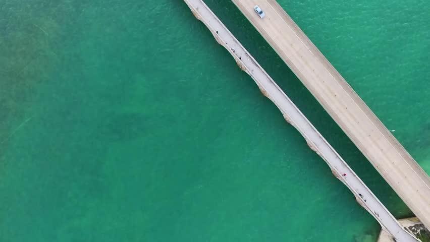 Aerial top view of vivid green ocean and Seven Mile Bridge on the Overseas Highway in the Florida Keys