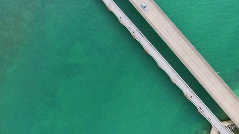 Aerial top view of vivid green ocean and Seven Mile Bridge on the Overseas Highway in the Florida Keys